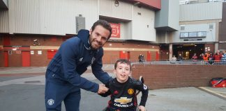 Juan Mata with MUDSA poster boy Alex Nield