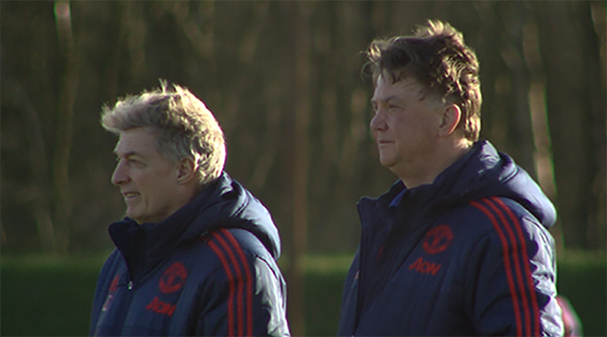 Louis Van Gaal (right) looks on