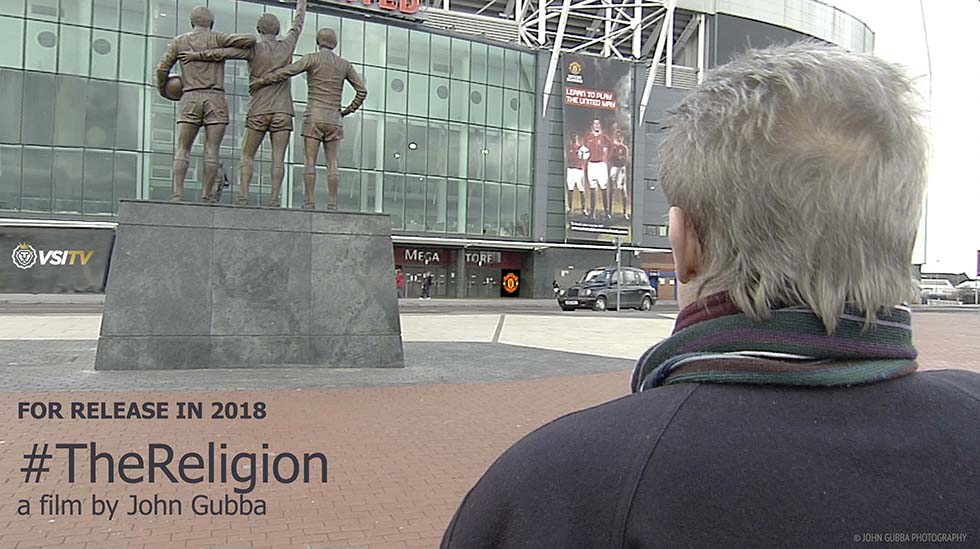 Denis Law and The Trinity statue. © John Gubba