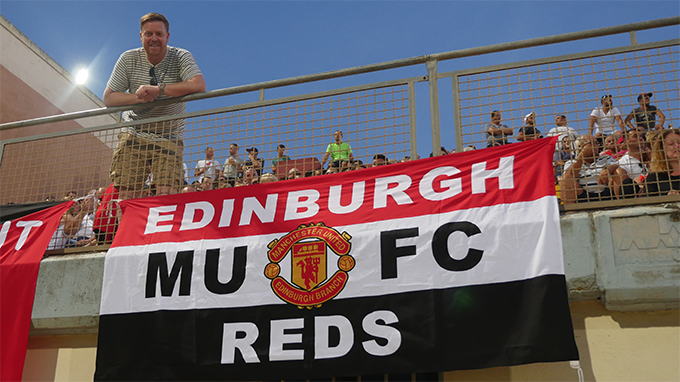 Peter Wood chairman of Edinburgh Supporters Club with one of the banners from the Scottish branch
