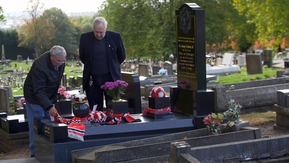 At Duncan Edward's graveside. Cousin Keith and second cousin Lawrence. Photo copyright John Gubba/visionsport