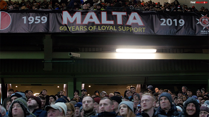 Celebrating 60 Years of loyal support MUSC Malta's banner hangs proudly at Old Trafford