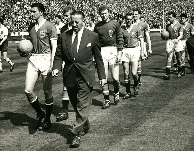 JimmYyMurphy leads out Manchester United's 1958 FA Cup Final team at Wembley flanked by Bill Foulkes (left) and Harry Gregg (behind him)