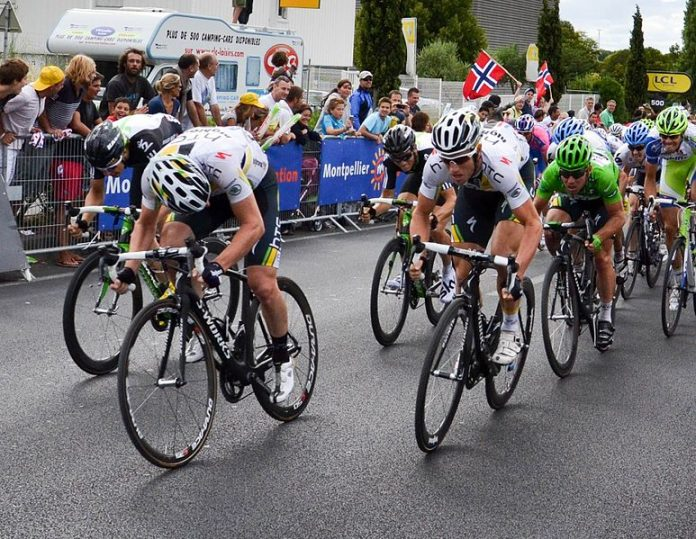 Mark Cavendish (green jersey), being led home in stage Stage 11, 2011 Tour de France.Source: wikipedia