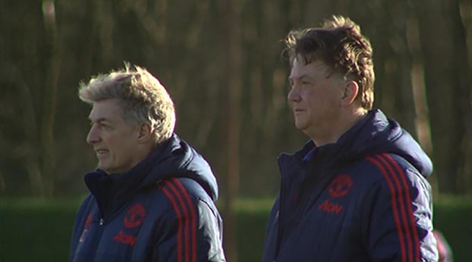 Louis Van Gaal (right) looks on