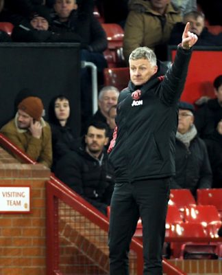 Ole Gunnar Solskjaer points the way in front of Old Trafford dugout