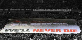 We'll Never Die flag surfing Stretford End
